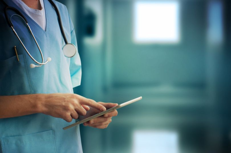 Doctor uses tablet in a hospital