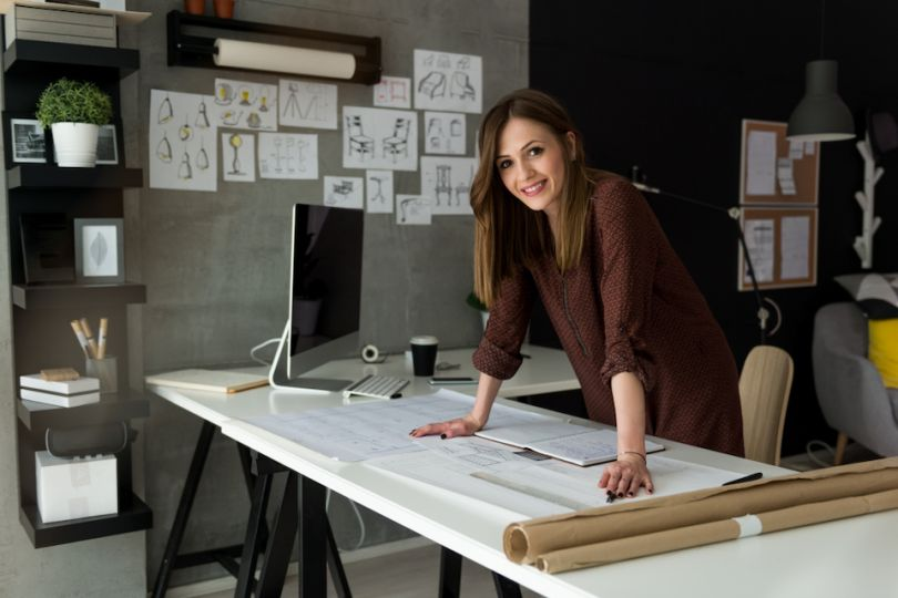 Female designer standing in her studio