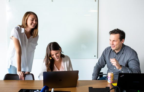 ServiceNow team members laughing in conference room